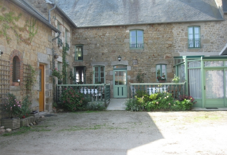 Trading B&B with Gîte, gardens, terrace, off road parking for guests, garages, stone barn.